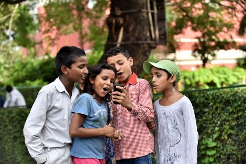 Children from slums and mobile phone use, at St. Columba's School, Delhi