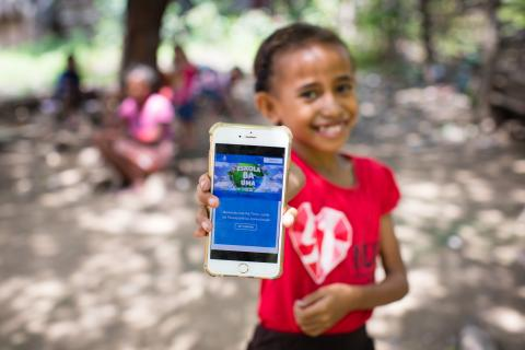 A girl shows off the Learning Passport via a mobile app.